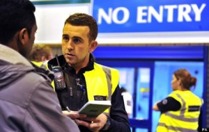 UK Border Agency officials question people during a raid at Bestway Cash and Carry in Liverpool.