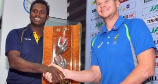 In this photograph taken on July 13, 2016, Australian cricket captain Steven Smith (R) and Sri Lankan cricket captain Angelo Mathews shake hands at the launch ceremony ahead of the Australian three-Test tour, at the Sri Lanka Cricket headquarters in Colombo.   The first Test will be played in Colombo from July 26.   / AFP / STR        (Photo credit should read STR/AFP/Getty Images)