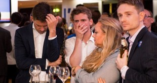 Supporters of the 'Stronger In' Campaign react as results of the EU referendum are announced at a results party at the Royal Festival Hall in London on June 23, 2016. Bookmakers dramatically reversed the odds on Britain leaving the European Union on Friday as early results from a historic referendum pointed to strong support for a Brexit. / AFP PHOTO / POOL / ROB STOTHARDROB STOTHARD/AFP/Getty Images